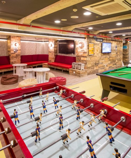 BCN_ Interiors_ foosball pool table chairs television beanbags_ LR_ Sinue Serra_Anwar approved_